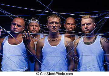 Group of men tangled in threads in ultraviolet
