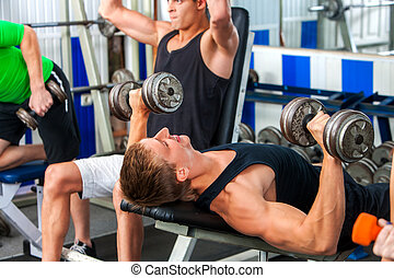 Group of men working his body at gym.