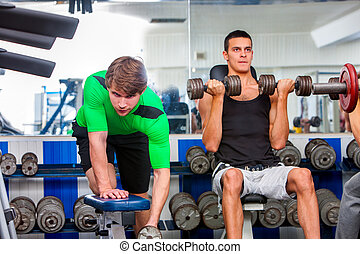 Group of men working his body at sport gym.