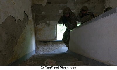 Group of military soldiers armed training at the tactical exercise in an abandoned building