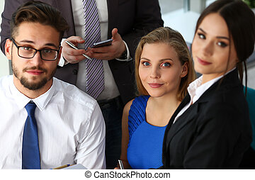 Group of modern businesspeople in office