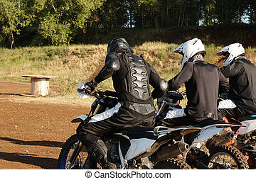 Group of motorcyclists preparing for race