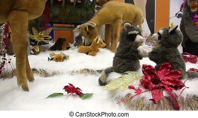 Group of moving plush toy animals on artificial snow