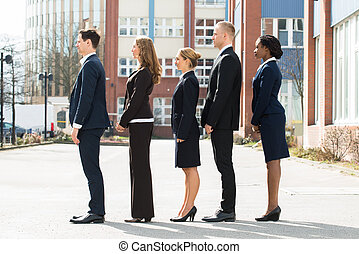 Multi-ethnic Businesspeople Standing In A Line