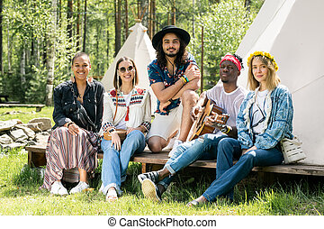 Group of multi-ethnic friends resting together - Group of ...