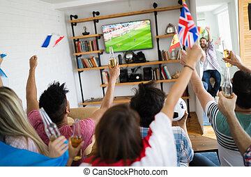 Group of multi-ethnic people celebrating football game