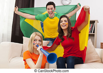 Group of multi national football fans cheering