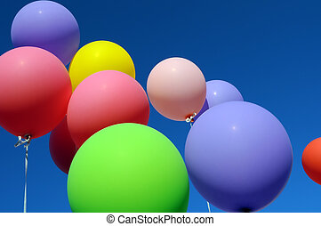 group of multicolored balloons in the city festival