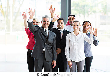 group of multicultural businesspeople waving