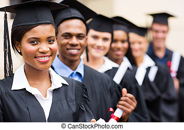 group of multicultural university graduates standing in a...