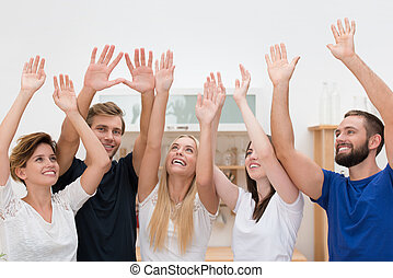 Group of multiethnic friends cheering - Group of attractive...