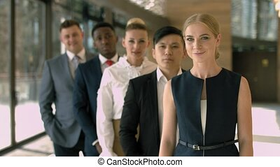 Group of multiracial business team standing in a row in the lobby