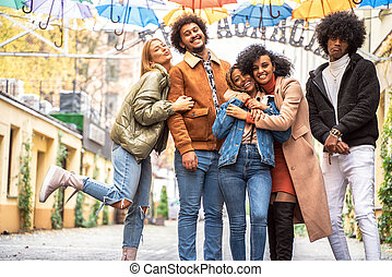 Group of multiracial friends having fun together outdoor