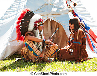 Group of North American Indians about a wigwam