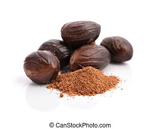 Group of nutmegs (seeds of Myristica fragrans), whole and...