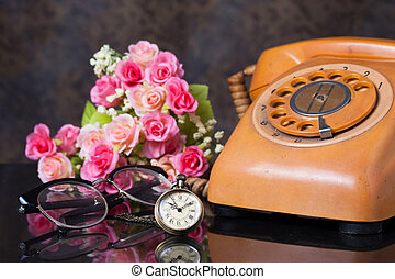 Group of objects on a granite, old watch, old telephone, ...