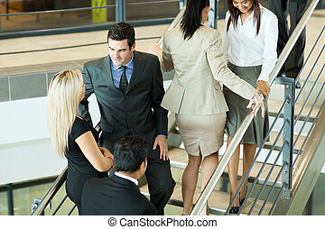 group of office workers walking on stairs