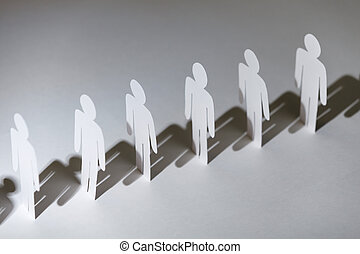 Group of papermen standing in a row