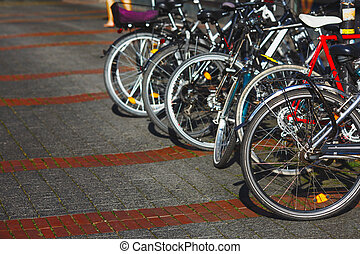 Group of parked city bikes on a street