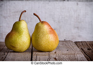 Group of pears on wood