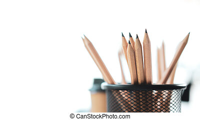 Group of pencils on desktop.