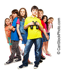 Group of people and confident boy with binoculars