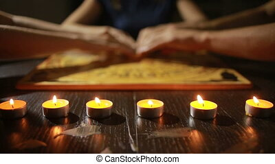 group of people at a spiritualistic. people call spirits