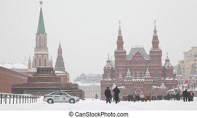 Group of people at Moscow Red Square under snowfall