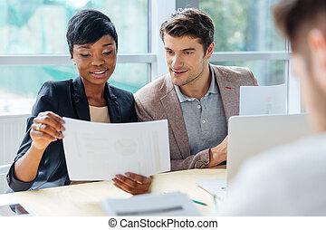 Group of people brainstorming on meeting in office