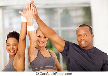 group of people celebrating after exercise - group of...