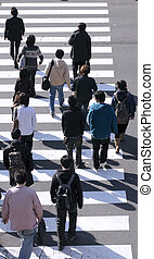 Group of people crossing the street-upper view during the ...