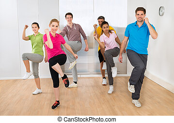 Group Of People Dancing In Gym