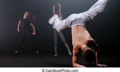 Group of people dancing. Mid shot