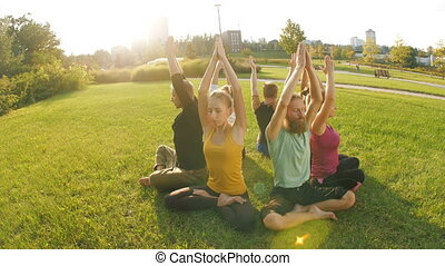 Group of people do yoga