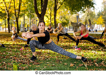 group of people doing outdoor workout