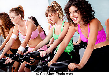 group of people doing spinning