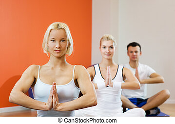 Group of people doing yoga exercise