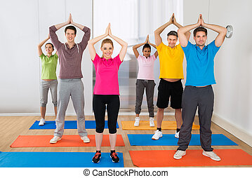 Group Of People Doing Yoga Exercising