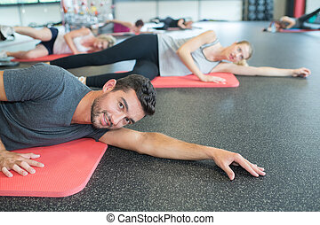 group of people doing yoga studio
