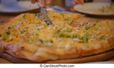 group of people eat pizza indoors at a cafe. close-up children teens eating fast food in cafe slow motion video