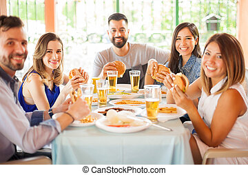 Group of people eating hamburgers