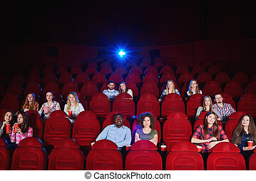 Group of people enjoying movie at the cinema