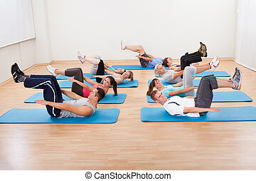 Group of people exercising in a gym class