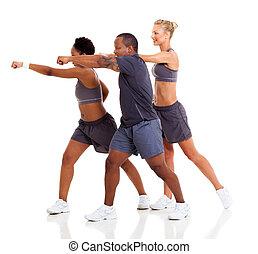 group of people exercising karate