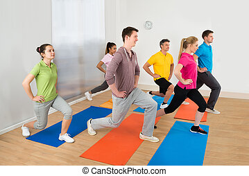 Group Of People Exercising On Mat - Group Of Happy...