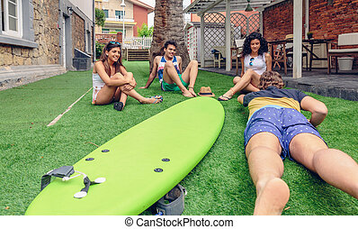 Group of people having fun in a surf class