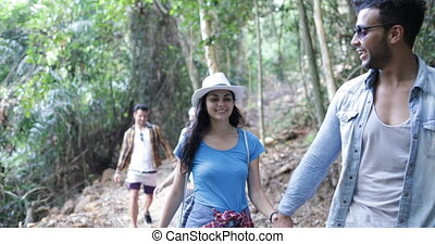 Group of People Hiking In Forest Talking Happy Smiling, Mix...