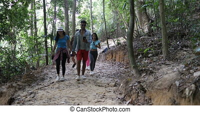 Group of People Hiking In Forest Use Map On Cell Smart...
