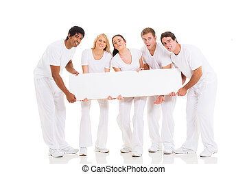 group of people holding heavy billboard
