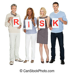 Group of people holding sign board illustrating risk